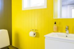The yellow bathroom on the ground floor.